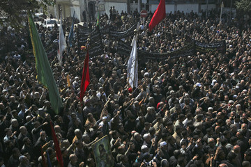 Iraqi Shi'ites chant slogans during a protest in Baghdad