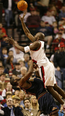 TRAIL BLAZERS PATTERSON SHOOTS OVER HILARIO OF THE NUGGETS.