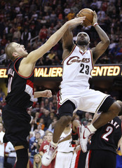 Cleveland Cavaliers LeBron James puts up a shot over Portland Trail Blazers Joel Przybilla in Cleveland