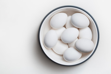 Hen eggs in a white bowl