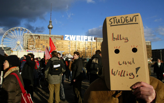 A student covers his face during a demonstration against plans to introduce fees for students in Berlin.