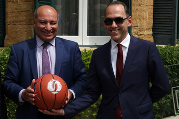 EBRD President Chakrabarti and Cyprus' Finance Minister Georgiades pose for a photo before a basketball event organised by EBRD inside the UN-controlled buffer zone in Nicosia