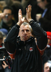 Charlton Athletic's newly appointed manager Pardew reacts during their English Premier League soccer match against Fulham at The Valley Stadium in London