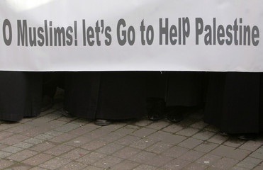Islamist protesters stand behind a banner to protest against Israel's attack on Gaza during a demonstration in Istanbul
