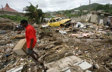 Resident checks damage after Hurricane Dean passed Bull Bay area in Kingston