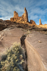 USA, Utah. Zeus and Moses, with clouds, boulders and rabbit brush in Canyonlands National Park