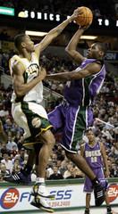 Milwaukee Bucks Mason attempts a shot over Seattle SuperSonics Lewis.