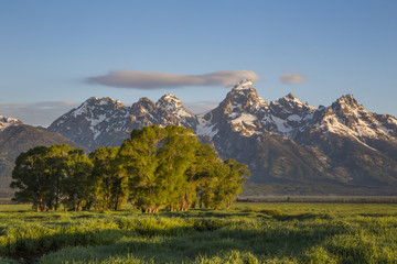 USA, Wyoming, Grand Teton National Park, small cloud hits the top of the Grand Teton in the springtime.