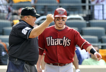 Arizona Diamondbacks runner Montero argues with home plate umpire Culbreth as he calls him out on a late tag by New York Mets in their MLB baseball game in New York