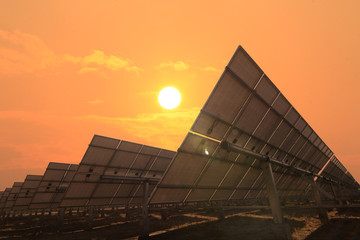 solar panels face sunlight with sky warm