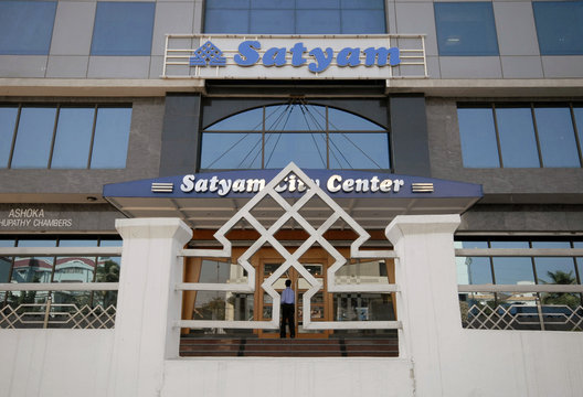 An employee of Satyam enters the office building in Hyderabad