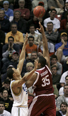 UCLA's Ryan Hollins guards Alabama's Richard  Hendrix during NCAA men's basketball tournament in San Diego, California