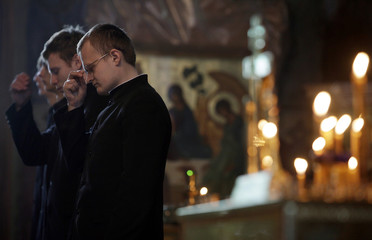Orthodox seminarists attend a commemorative service for victims of the Lame Horse nightclub fire, in the Cathedral of Life-giving Trinity in Perm