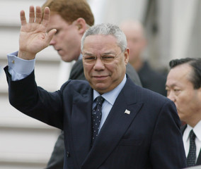 US SECRETARY OF STATE POWELL WAVES ON ARRIVAL IN TOKYO.