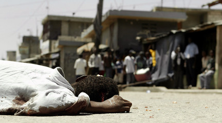Haitian lies dead on street after clashes in neighborhood of Cite-Militare in Port-au-Prince