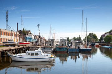 Fotobehang Poort Sailing ships moored in harbor