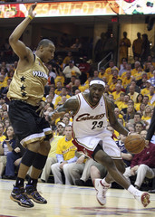 Cavaliers James drives past Wizards Butler during the first quarter of Game 2 of their NBA  basketball playoff series in Cleveland