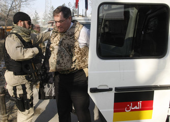 German Defence Minister Jung wears a flak jacket upon his arrival at the ISAF headquarter in Kabul