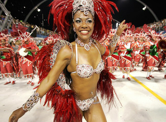 A dancer performs during X-9 samba school's parade at the sambodrome in Sao Paulo