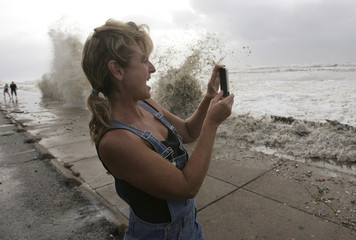 Woman takes picture of rising seas caused by Hurricane Ike in Galveston, Texas