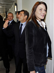 France's President Sarkozy waves as he visits the Paoli-Calmettes Institute with his wife Carla Bruni-Sarkozy in Marseille