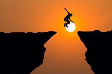 Man jump through the gap between hill,Business concept idea.