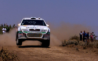 KENNETH ERIKSSON FROM SWEDEN IS AIR BONE IN NTULELE ON LEG TWO OF THESAFARI RALLY.