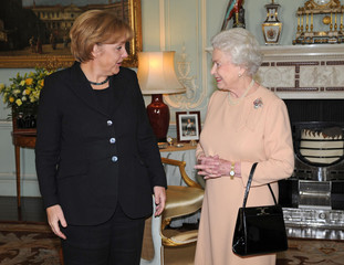 Britain's Queen Elizabeth receives German Chancellor Angela Merkel at Buckingham Palace in London