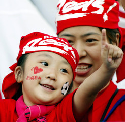 """A young South Korean soccer fan wears a bandana with the logo of the """"Red Devils"""" soccer fan club of.."""