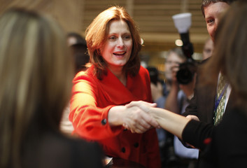 The wife of Britain's Prime Minister, Sarah Brown, visits exhibitors during the annual Labour Party conference in southern England