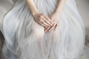 A bride's morning and beautiful ring and dress