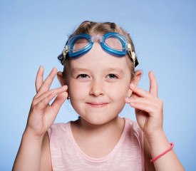 champion in the blue glasses for swimming