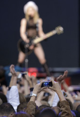 Spectator takes a picture of the Madonna during her Sticky and Sweet tour at the Dvortsovaya square in St.Petersburg