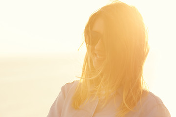 A girl smiling on the sunset