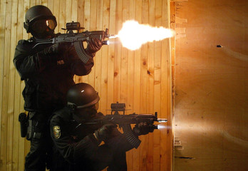 Bulgarian police special anti-terrorist unit members shoot on a shooting range during a drill at the..