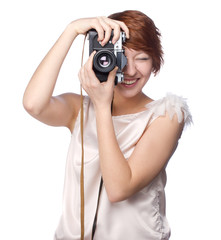 Attractive funny girl with a camera over white