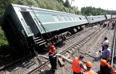 Russian specialists get ready for lifting the train at the site of an explosion 150 km south of Moscow.