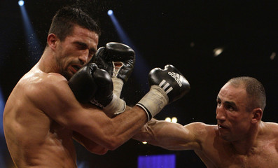 IBF middleweight World champion Abraham of Germany punches his compatriot Oral during the IBF world middleweight championships in Berlin