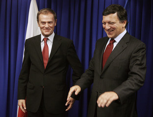 President of the European Commission Barroso gestures as he meets with Tusk , leader of Platforma Obywatelska Party, at the European Union Centre in Warsaw