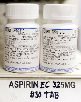 Generic Aspirin pain medication pills are shown in the pharmacy of the J.W.C.H. safety-net clinic in downtown Los Angeles