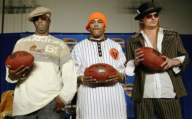P DIDDY KID ROCK AND NELLY POSE FOR PHOTOGRAPHERS AT SUPER BOWL PRESS CONFERENCE IN HOUSTON.