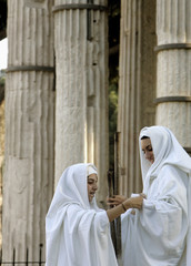 Members of a historical re-enactment society take part in a performance showing the antique ritual of the Vestals in Rome
