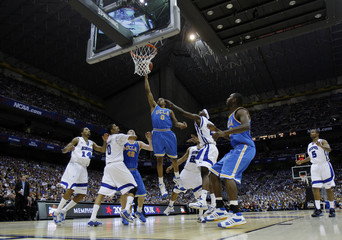 UCLA Westbrook drives to the basket against the defense of the Memphis Tigers during their NCAA Men's Final Four semi-final basketball game in San Antonio