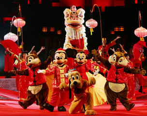Disney's cartoon characters perform with lion dancers at Hong Kong Disneyland to celebrate Chinese Lunar New Year
