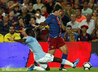Barcelona's Maxwell fights for the ball against Manchester City's Wright-Phillips during a friendly match for the Joan Gamper trophy in Barcelona