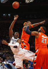 University of Connecticut's Adrien lays up a shot past Syracuse defenders during first half at the 2009 NCAA Big East men's college basketball tournament in New York