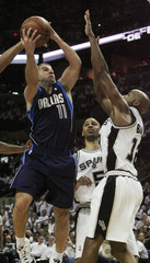 Dallas Mavericks' Barea shoots against San Antonio Spurs' Udoka and Bowen during Game 2 in the first round of the NBA Western Conference basketball playoffs in San Antonio
