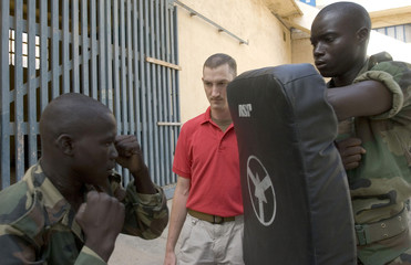U.S. Navy MA Kurtis Chapman directs an unarmed combat self defence exercise with local sailors on Senegal's Naval base in Dakar