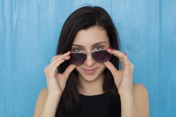 Portrait of a beautiful brunette girl in sunglasses.