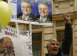 A supporter of far-right Greater Romania Party shouts slogans while listening to their leader Vadim Tudor in Bucharest